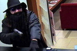 This image of a bank robber was taken inside a Bank of America branch in McLean, Virginia, on Jan. 2, 2015.  Investigators believe it was the first of a series of related bank robberies in the D.C. suburbs. (FBI)