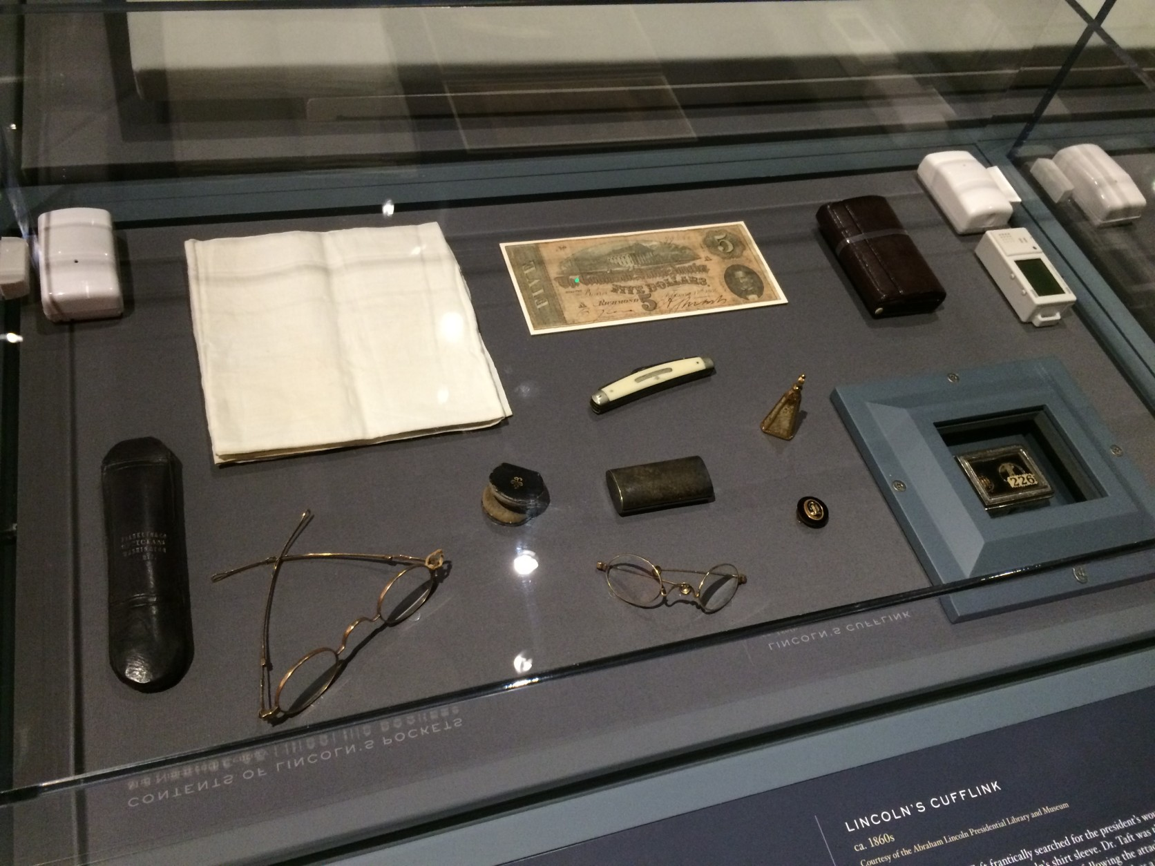 Here are the items in Abraham  Lincoln's pockets when he was shot. (WTOP/Nick Iannelli)