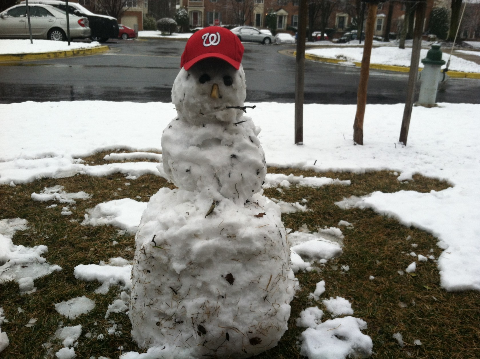 This snow man is ready for spring and the Nationals home opener.  (WTOP/Mike Jakaitis)