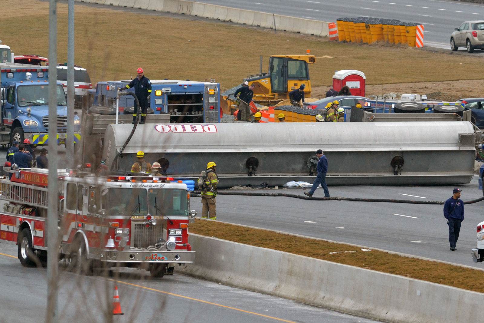 Emergency crews respond to a crash involving a  tanker truck overturned on Interstate 95 in Laurel, Md., after a crash Tuesday morning. The tanker lost more than 700 gallons of fuel. (Courtesy Bill Vaughan)