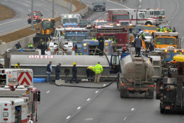 A tanker truck lies across Interstate 95 after a crash Tuesday morning. The tanker lost more than 700 gallons of fuel. (Courtesy Bill Vaughan)