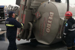 Crews respond to a tanker truck that overturned on Interstate 95 in Laurel Tuesday. (Prince George's County Hazmat/Craig Black)