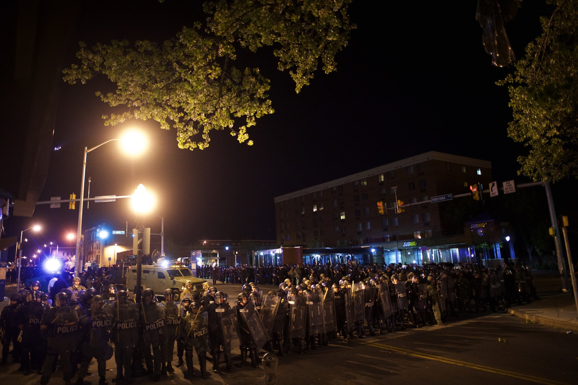 BALTIMORE, MD - APRIL 28:  Riot police line the street after curfew and dispensing tear gas the night following citywide riots over the death of Freddie Gray on April 28, 2015 in Baltimore, Maryland. Freddie Gray, 25, was arrested for possessing a switch blade knife April 12 outside the Gilmor Houses housing project on Baltimore's west side. According to his attorney, Gray died a week later in the hospital from a severe spinal cord injury he received while in police custody. (Photo by Mark Makela/Getty Images)