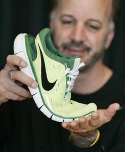 Jeff Pisciotta, senior researcher, Nike Sports Research Lab, shows off a series of scores in the Nike Free 5.0 shoe, that allow it to twist and turn with the foot, during a presentation Wednesday, March 30, 2005, in Beaverton, Ore. Barefoot running is a popular training technique, and some have incorporated it into competition. Sprightly Zola Budd, a South African competing for Britain in the 1984 Olympics, was running barefoot when she got tangled up withMary Decker. (AP Photo/Rick Bowmer)