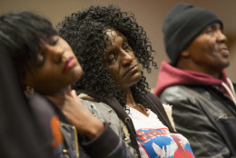 Family members of Freddie Gray, sister Fredricka Gray, left, mother Gloria Darden, center, and stepfather Richard Shipley listen during a news conference after a day of unrest following the funeral of Freddie Gray on Monday, April 27, 2015, in Baltimore. Rioters plunged part of Baltimore into chaos torching a pharmacy, setting police cars ablaze and throwing bricks at officers. (AP Photo/Evan Vucci)