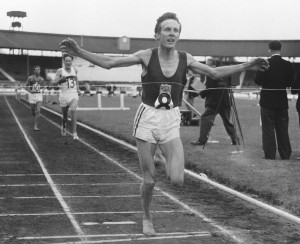"""Bruce Tulloh, 24, a 112-pound botanist, wins the six-mile run in British games at London's White City on June 11, 1962, with Martin Hyman trailing in second spot. His time was 27: 57.4 compared to the world mark of 27:43.8 held by Sandor Iharos of Hungary. Tulloh knows he's considered something of an eccentric because he runs barefoot, but he says """"It makes you feel free. It also makes you lighter, but I guess it's really psychological."""" He say his feet are """"tough as leather."""" (AP Photo)"""