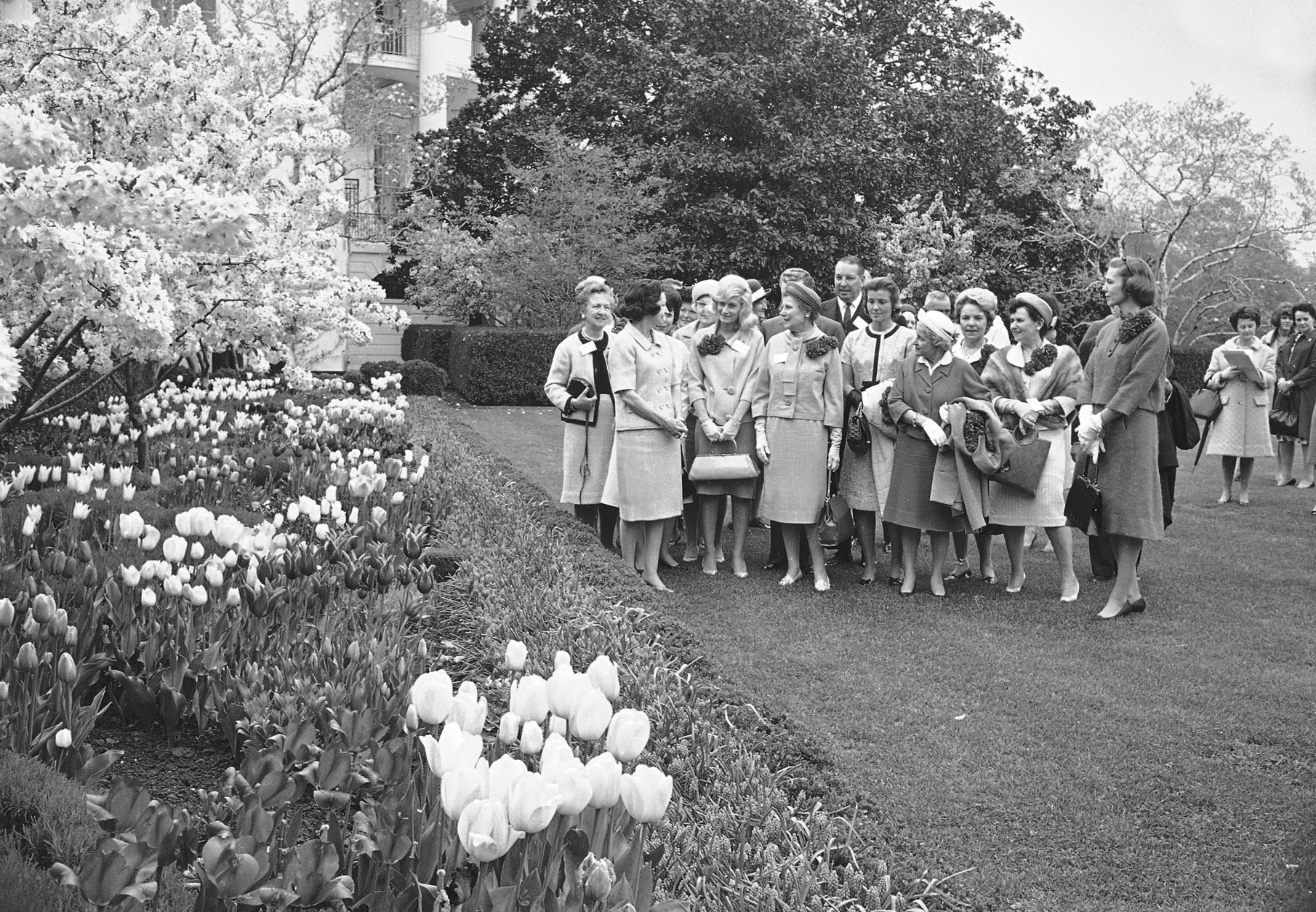 """Lady Bird Johnson, left, wife of Pres. Johnson, takes a group of leaders of a """"Let's Beautify America"""" campaign on a tour of the White House flower garden, April 28, 1965.  The group gave Mrs. Johnson a report on what some of the nation's cities are doing to make themselves more beautiful.  (AP Photo)"""