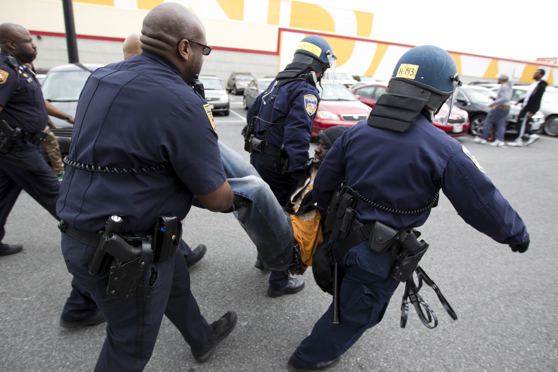 Baltimore police officers detain a demonstrator after clashes with police, after the funeral of Freddie Gray, Monday, April 27, 2015, at New Shiloh Baptist Church in Baltimore. Gray died from spinal injuries after he was arrested and transported in a Baltimore Police Department van. (AP Photo/Jose Luis Magana)