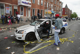 BALTIMORE, MD - APRIL 27: A Baltimore Police car destroyed by demonstrators sits in the street near the corner of Pennsylvania and North avenues during violent protests following the funeral of Freddie Gray April 27, 2015 in Baltimore, Maryland. Gray, 25, who was arrested for possessing a switch blade knife April 12 outside the Gilmor Homes housing project on Baltimore's west side. According to his attorney, Gray died a week later in the hospital from a severe spinal cord injury he received while in police custody. (Photo by Chip Somodevilla/Getty Images)