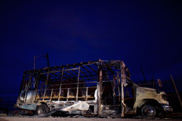 BALTIMORE, MD - APRIL 28: The remains of a senior center bus set ablaze during night riots are seen at dawn on April 28, 2015 in Baltimore, Maryland. Freddie Gray, 25, was arrested for possessing a switch blade knife April 12 outside the Gilmor Houses housing project on Baltimore's west side. According to his attorney, Gray died a week later in the hospital from a severe spinal cord injury he received while in police custody. (Photo by Mark Makela/Getty Images)