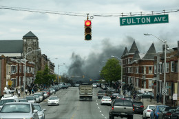 BALTIMORE, MD - APRIL 27: Smoke billows at the intersection of Pennsylvania Avenue and North Avenue (seen from Fulton Ave), April 27, 2015 in Baltimore, Maryland. Riots have erupted in Baltimore following the funeral service for Freddie Gray, who died last week while in Baltimore Police custody. (Photo by Drew Angerer/Getty Images)