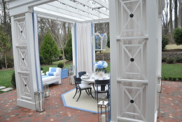 The blue and white color palette of the outdoor patio complements the natural greens of the outdoors, Sroka says. (WTOP/Rachel Nania)
