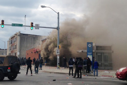 Smoke billows from a CVS Pharmacy store in  Baltimore on Monday, April 27, 2015. Demonstrators clashed with police after the funeral of Freddie Gray. Gray died from spinal injuries about a week after he was arrested and transported in a Baltimore Police Department van. (AP Photo/Juliet Linderman)