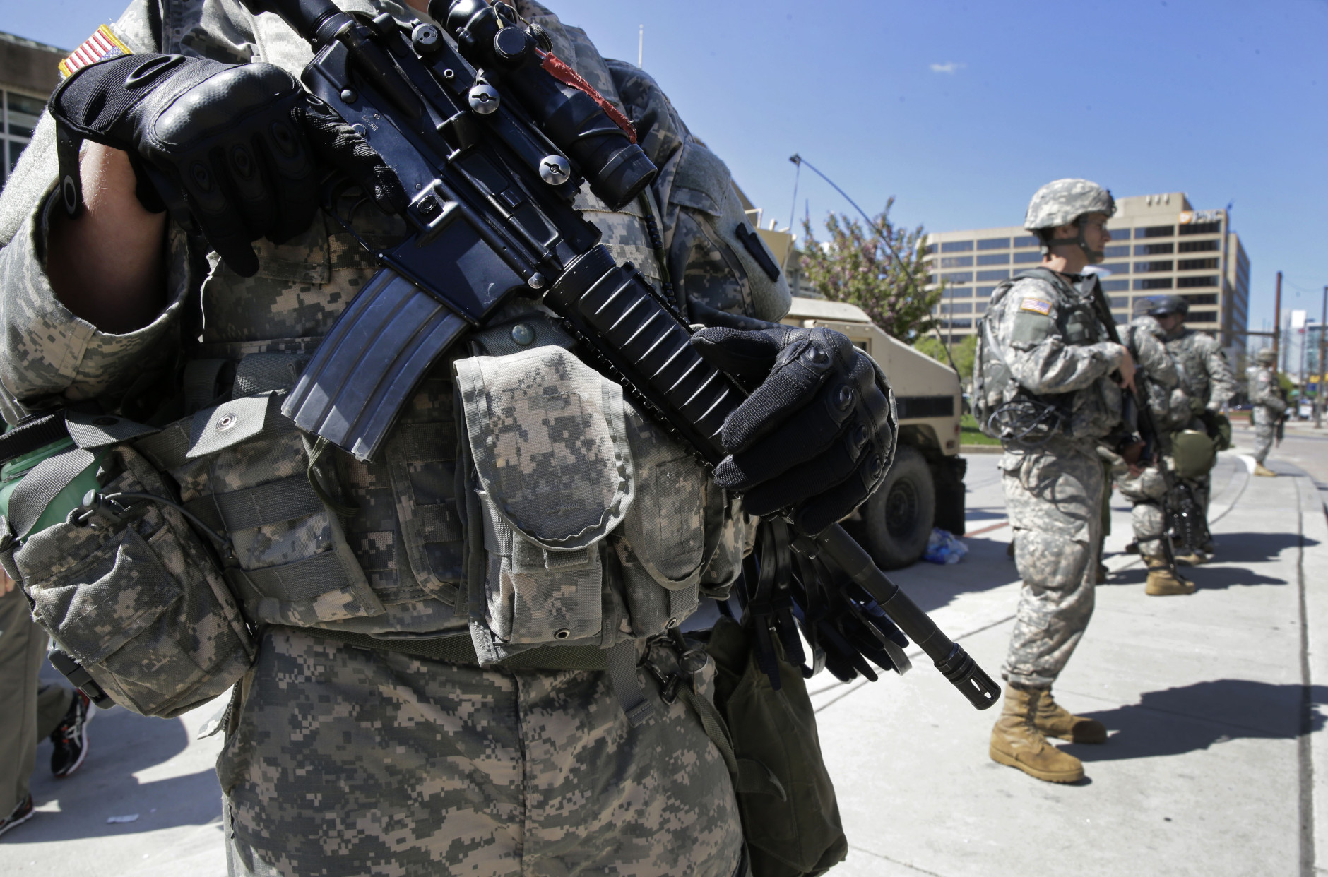 Maryland National Guardsmen patrol near downtown office buildings, Tuesday, April 28, 2015, in Baltimore, a day following unrest that occurred after Freddie Gray's funeral. Gray died from spinal injuries about a week after he was arrested and transported in a Baltimore Police Department van. His death has become the latest flashpoint in the nation's debate over the police use of force against black men. (AP Photo/Patrick Semansky)