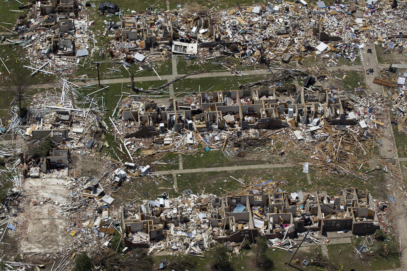 FILE — In this May 7, 2011 aerial file photo, tornado damage is seen in Tuscaloosa, Ala. America's wild weather year has hit yet another new high: a devastating dozen billion-dollar catastrophes. The National Oceanic and Atmospheric Administration announced Wednesday that it has recalculated the number of weather disasters passing the billion dollar mark, with two new ones, pushing 2011's total to 12. The two costly additions are the Texas, New Mexico and Arizona wildfires and the mid June tornadoes and severe weather. (AP Photo/Dave Martin, File)