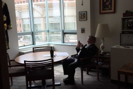 The National Research Council fellowships office director Dr. H Ray Gamble uses his phone during a massive power outage. (Courtesy Morgan Mounts of the National Academy of Sciences)