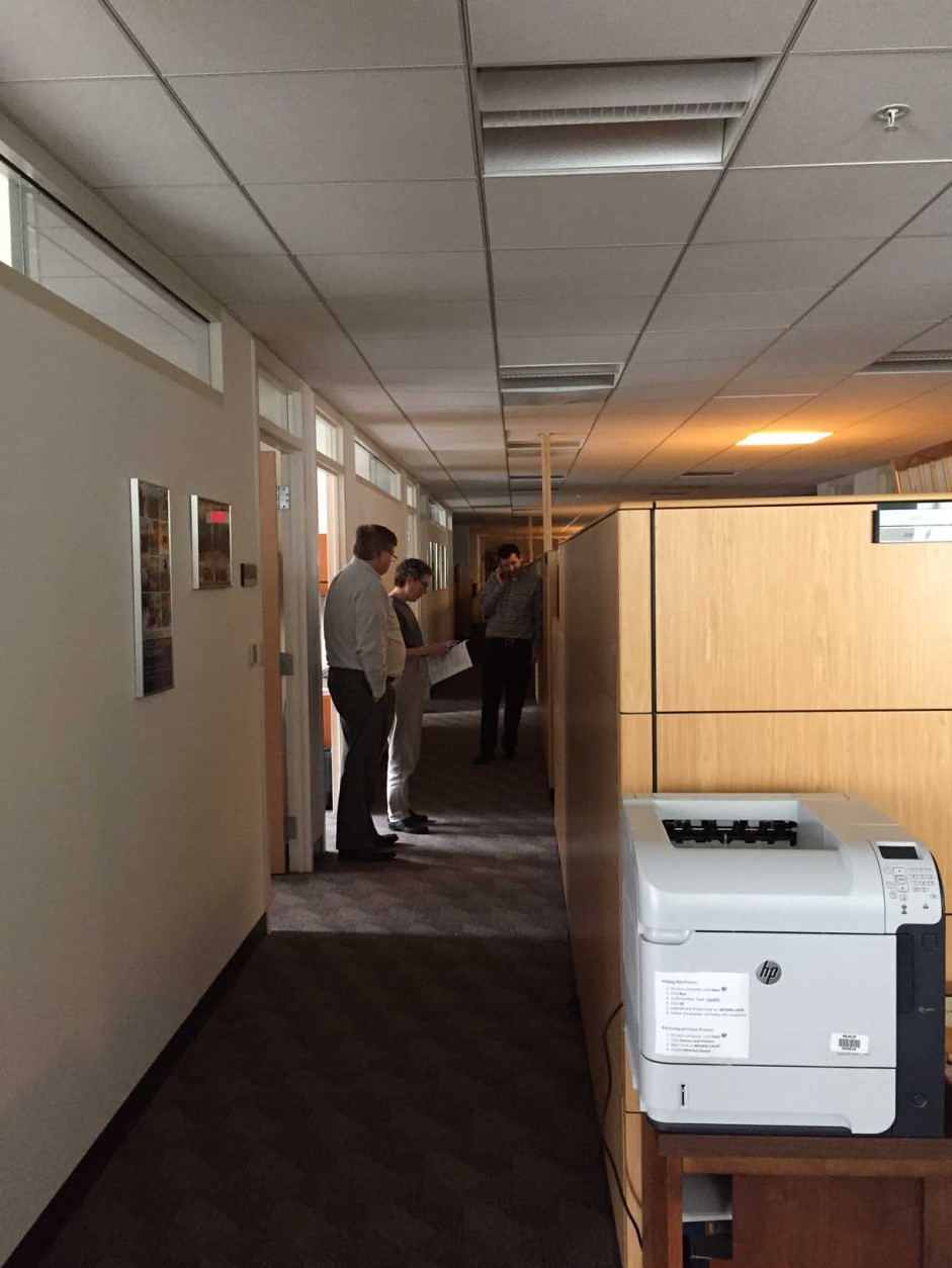 Staffers at the National Academy of Sciences gather during a massive power outage. (Courtesy Morgan Mounts of the National Academy of Sciences)