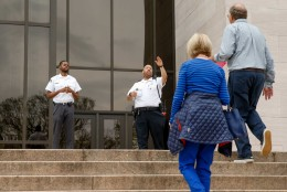 Security guards turn visitors away from the Smithsonian's National Air and Space Museum in Washington, Tuesday, April 7, 2015, after widespread power outages cause many of the buildings along the National Mall to shut down temporarily. Widespread power outages affected the White House, State Department, Capitol and other sites across Washington and its suburbs Tuesday afternoon — all because of an explosion at a power plant in southern Maryland, an official said.  (AP Photo/Andrew Harnik)