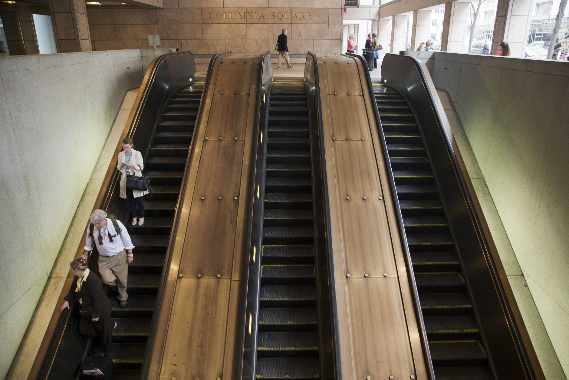 People ride the escalator into the Metro Center metro stop in downtown Washington, Tuesday, April 7, 2015. (AP Photo/Jacquelyn Martin)