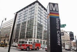A firetruck passes the Metro Center metro stop in downtown Washington, Tuesday, April 7, 2015, as power begins to return to the area after a brief outage. Widespread power outages affected the White House, State Department, Capitol and other sites across Washington and its suburbs Tuesday afternoon — all because of an explosion at a power plant in southern Maryland, an official said. (AP Photo/Jacquelyn Martin)