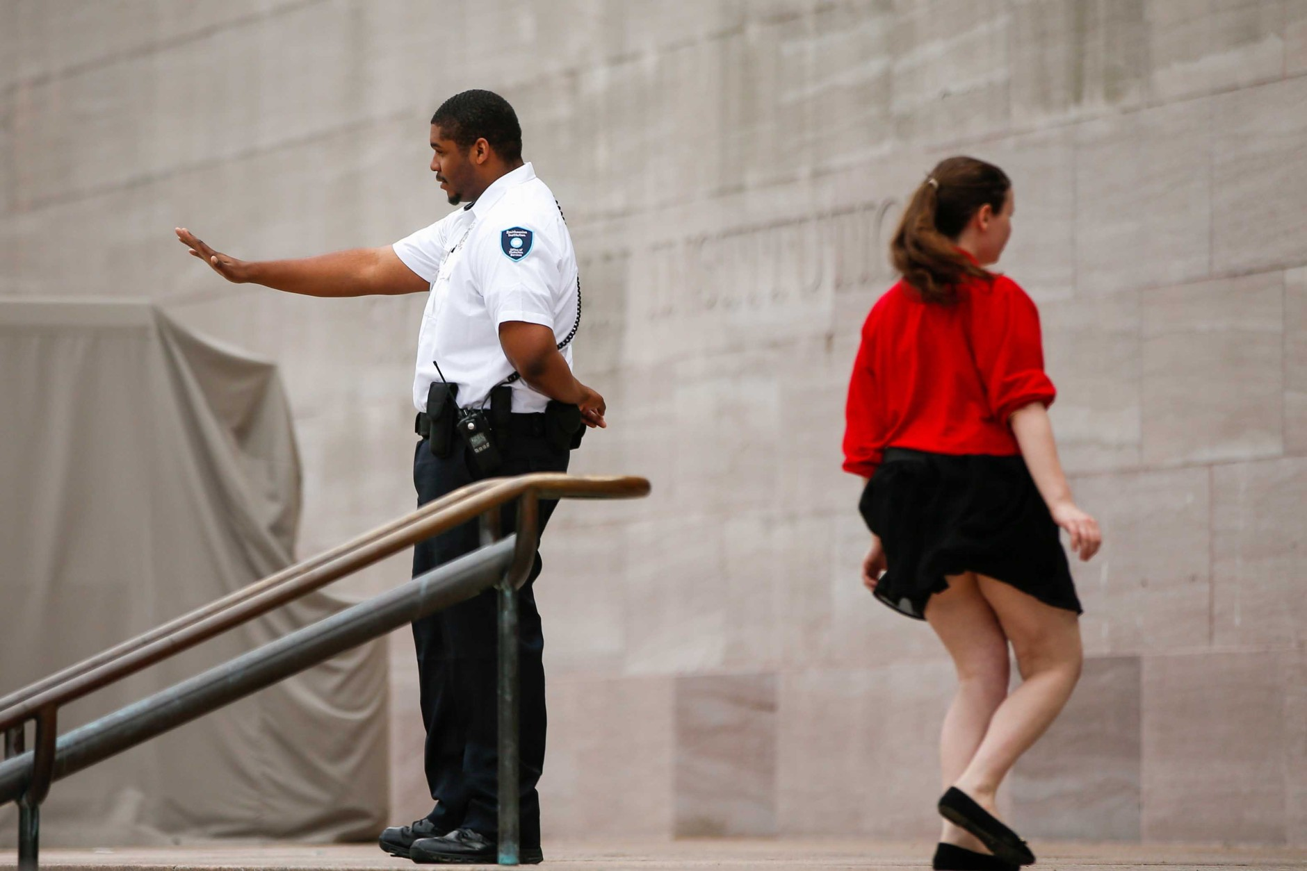 A security guard turns visitors away from the Smithsonian's National Air and Space Museum after widespread power outages caused many of the buildings along the National Mall in Washington to shut down temporarily, Tuesday, April 7, 2015. Widespread power outages affected the White House, State Department, Capitol and other sites across Washington and its suburbs Tuesday afternoon — all because of an explosion at a power plant in southern Maryland, an official said.  (AP Photo/Andrew Harnik)