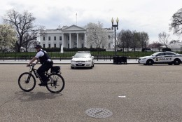 A Secret Service rides his bike on Pennsylvania Avenue outside the White House in Washington, Tuesday, April 7, 2015. The White House, State Department, and Capitol were all affected by reports of widespread power outages across Washington and its suburbs Tuesday afternoon.  (AP Photo/Susan Walsh)