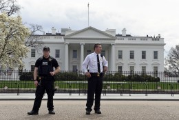 Members of the Secret Service stand on Pennsylvania Avenue outside the White House in Washington, Tuesday, April 7, 2015. The White House, State Department, and Capitol were all affected by reports of widespread power outages across Washington and its suburbs Tuesday afternoon.  (AP Photo/Susan Walsh)