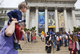 Chris Cellini of Charlotte, N.C., left, lifts his son Aiden Cellini, 5, onto his shoulders after a visit to the Natural History Museum on the National Mall in Washington, Tuesday, April 7, 2015. Widespread power outages affected the White House, State Department, Capitol and other sites across Washington and its suburbs Tuesday afternoon — all because of an explosion at a power plant in southern Maryland, an official said. (AP Photo/Jacquelyn Martin)