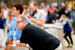 Michael and Julie Krieger of Poughkeepsie, N.Y. wait outside the Smithsonian's National Air and Space Museum for it to reopen after widespread power outages cause many of the buildings along the National Mall in Washington to shut down temporarily, Tuesday, April 7, 2015. Widespread power outages affected the White House, State Department, Capitol and other sites across Washington and its suburbs Tuesday afternoon — all because of an explosion at a power plant in southern Maryland, an official said.  (AP Photo/Andrew Harnik)
