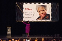 Oprah Winfrey gestures up as the lights go out during her speech at the unveiling of the Maya Angelou Forever Stamp, Tuesday, April 7, 2015, at the Warner Theater  in Washington. The White House, State Department, and Capitol were all affected by reports of widespread power outages across Washington and its suburbs Tuesday afternoon.  (AP Photo/Jacquelyn Martin)