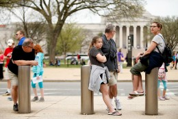 The National Gallery of Art is visible in the background as visitors to the Smithsonian's National Air and Space Museum wait for it to reopen after widespread power outages cause many of the buildings along the National Mall in Washington, to shut down temporarily, Tuesday, April 7, 2015. (AP Photo/Andrew Harnik)
