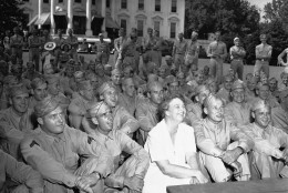 Mrs. Eleanor Roosevelt joined her guests  as she entertained at a Garden Party on June 12, 1942  in Washington at the south lawn of the White House for the over 400 soldiers detailed to guard the executive mansion. They were watching an entertainer. (AP Photo)