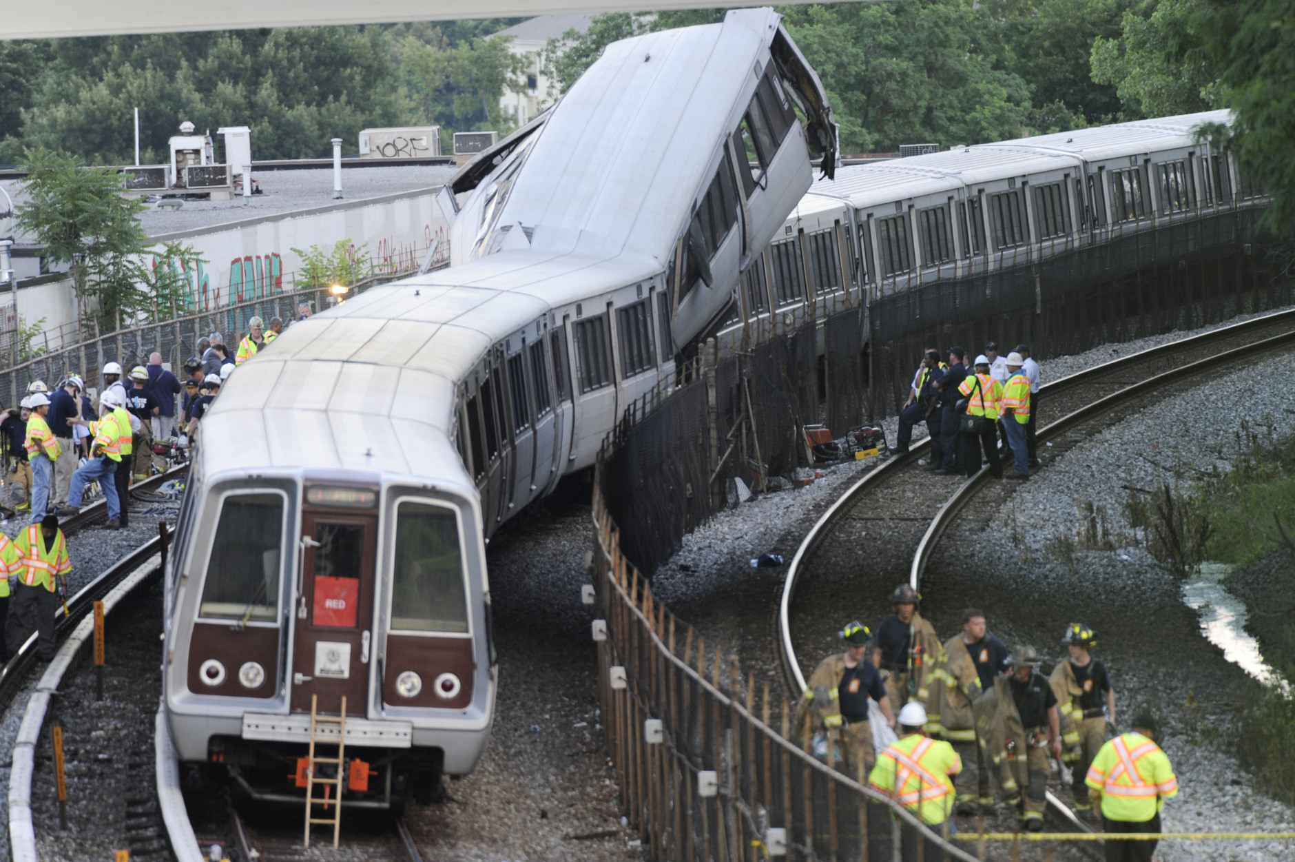 District of Columbia Fire and Emergency workers at the site of a rush-hour collision between two Metro transit trains in northeast Washington, D.C. Monday, June 22, 2009. (AP Photo/Pablo Martinez Monsivais)