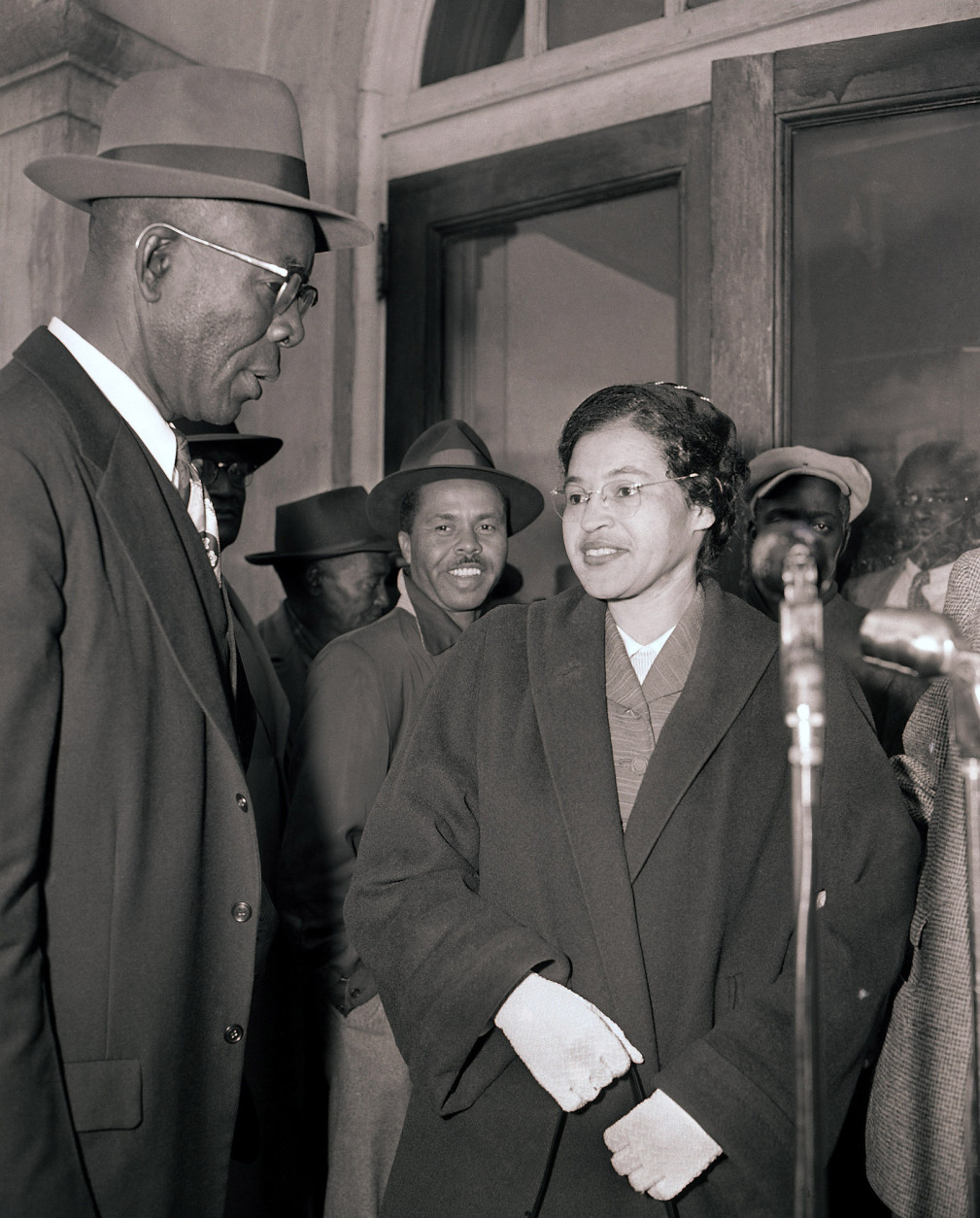 Mrs. Rosa Parks and E.D. Nixon, left, former president of the Alabama NAACP, arrive at court in Montgomery March 19, 1956 for the trial in the racial bus boycott.  Mrs. Parks was fined $14 on Dec. 5 for failing to move to the segregated section of a city bus.  The boycott started on the day she was fined.  There were 91 other defendants. (AP Photo/Gene Herrick)