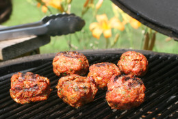 ** FOR USE WITH AP WEEKLY FEATURES **   Grilled Meatballs may sound like an odd idea, but this quick recipe has distinct tomato and savory notes and produces meatballs with tons of flavor that can be cooked entirely on the grill. For a great sandwich, toss slices of provolone cheese over them during the final minute of grilling. (AP Photo/Larry Crowe)