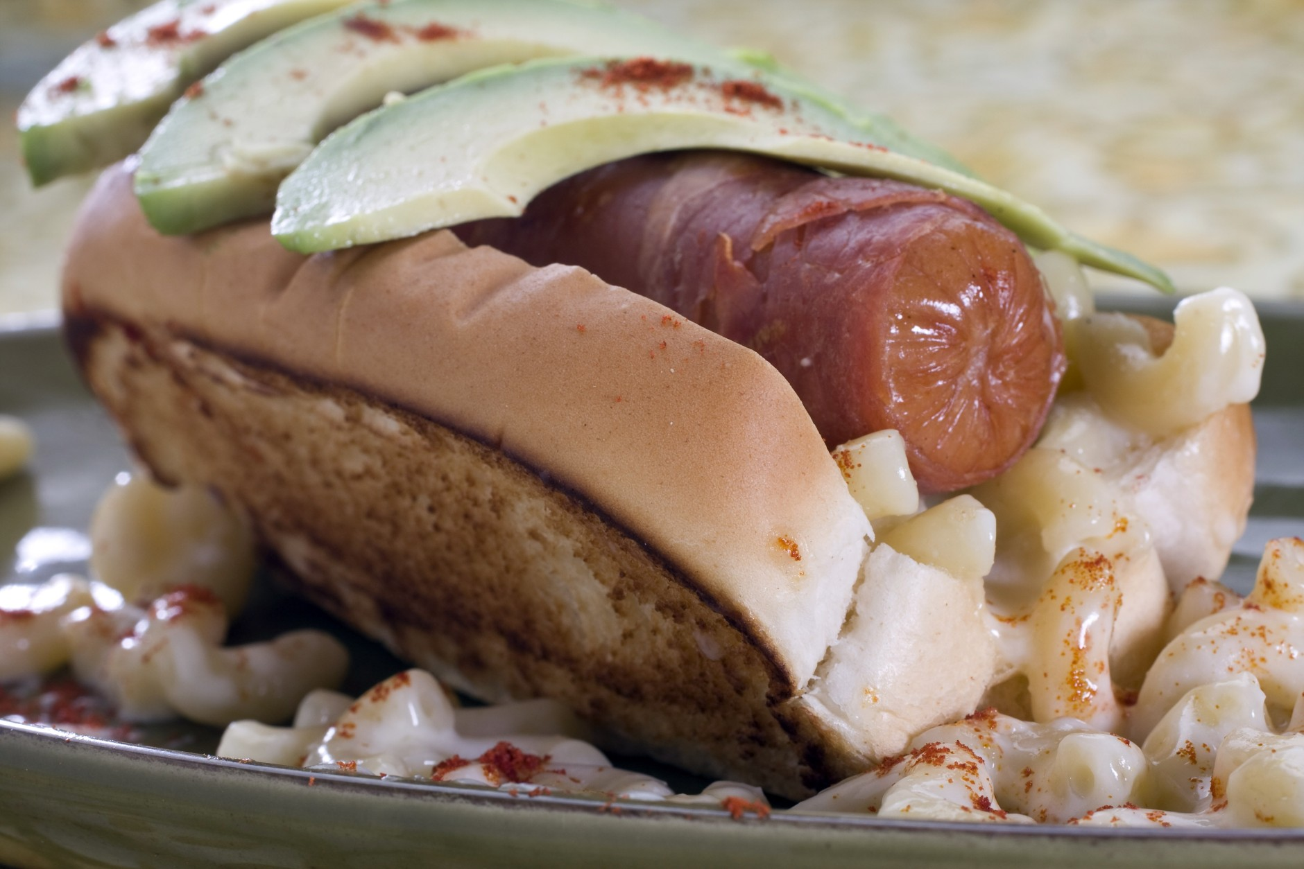 A maxed mac and cheese hotdog is seen in this May 2, 2010 photo. With a prosciutto wrap on the dog this recipe is a summer favorite in the extreme. (AP Photo/Larry Crowe)