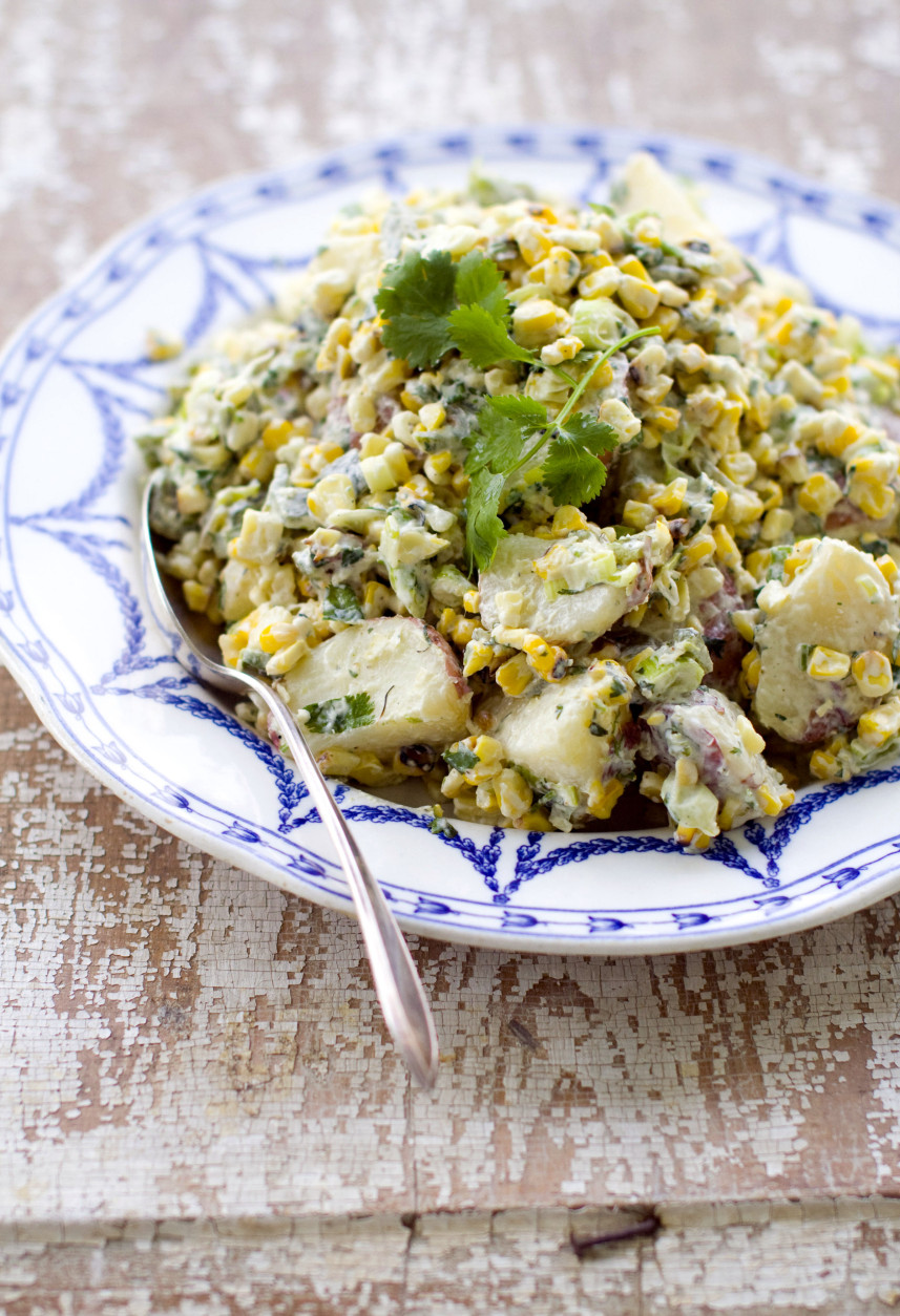 This Monday, July 11, 2011 photo shows potato salad studded with grilled corn and poblano peppers in Concord, N.H.  For Marcela Valladolid, salads are not starters. They are big and substantial.  For the AP's 20 Salads of Summer series, Valladolid offered this potato salad recipe.    (AP Photo/Matthew Mead)