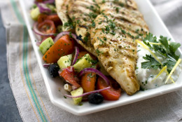 This Aug. 15, 2011 photo shows chef Elizabeth A. Karmel's lemon chicken steaks with summer salad and tzatziki in Concord, N.H. This recipe is perfect for the end of summer when farmers markets and backyard gardens are bursting with cucumbers and tomatoes.  (AP Photo/Matthew Mead)