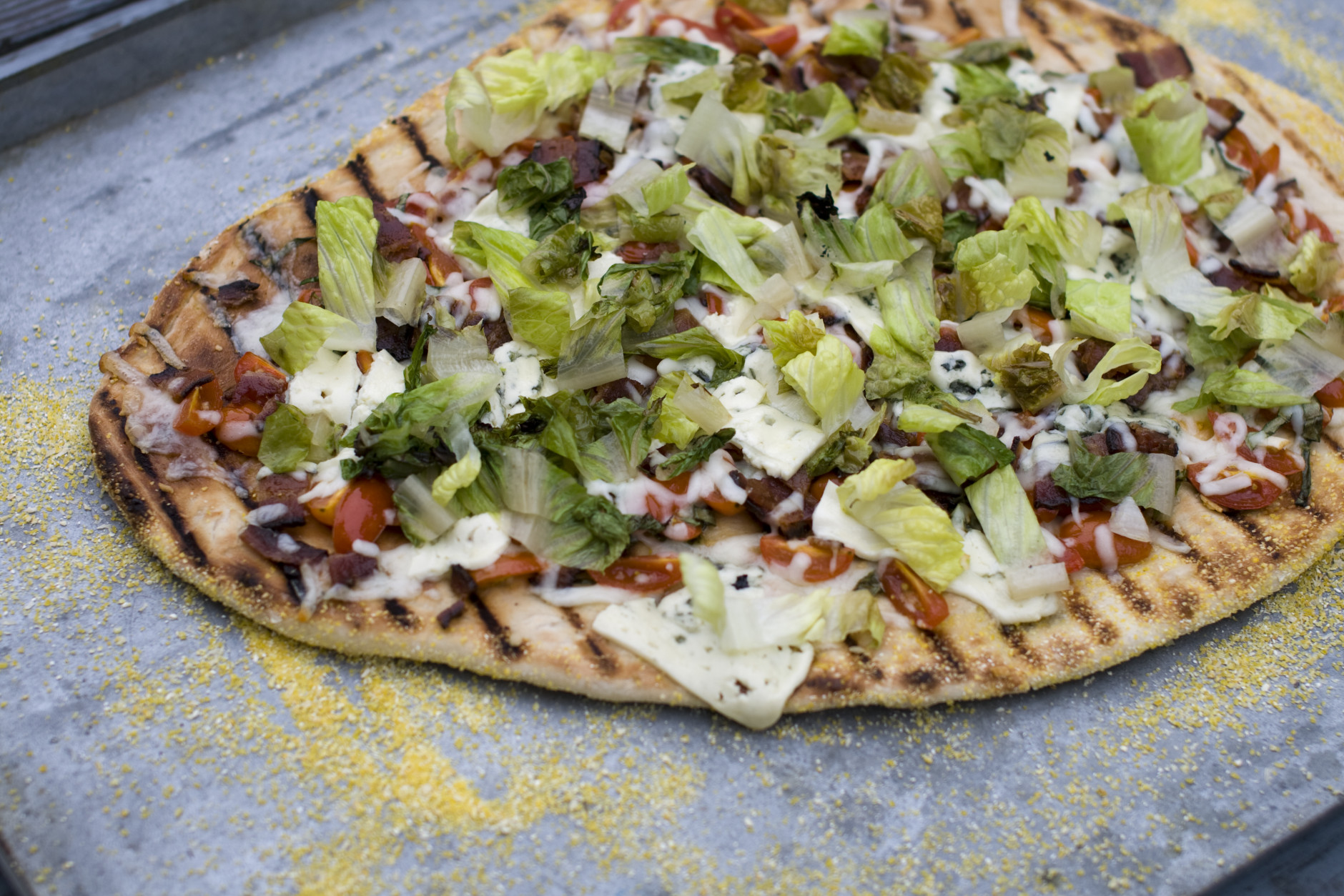This July 22, 2013 photo taken in Concord, N.H., shows a recipe for grilled BLT pizza with summer tomato-basil sauce. (AP Photo/Matthew Mead)