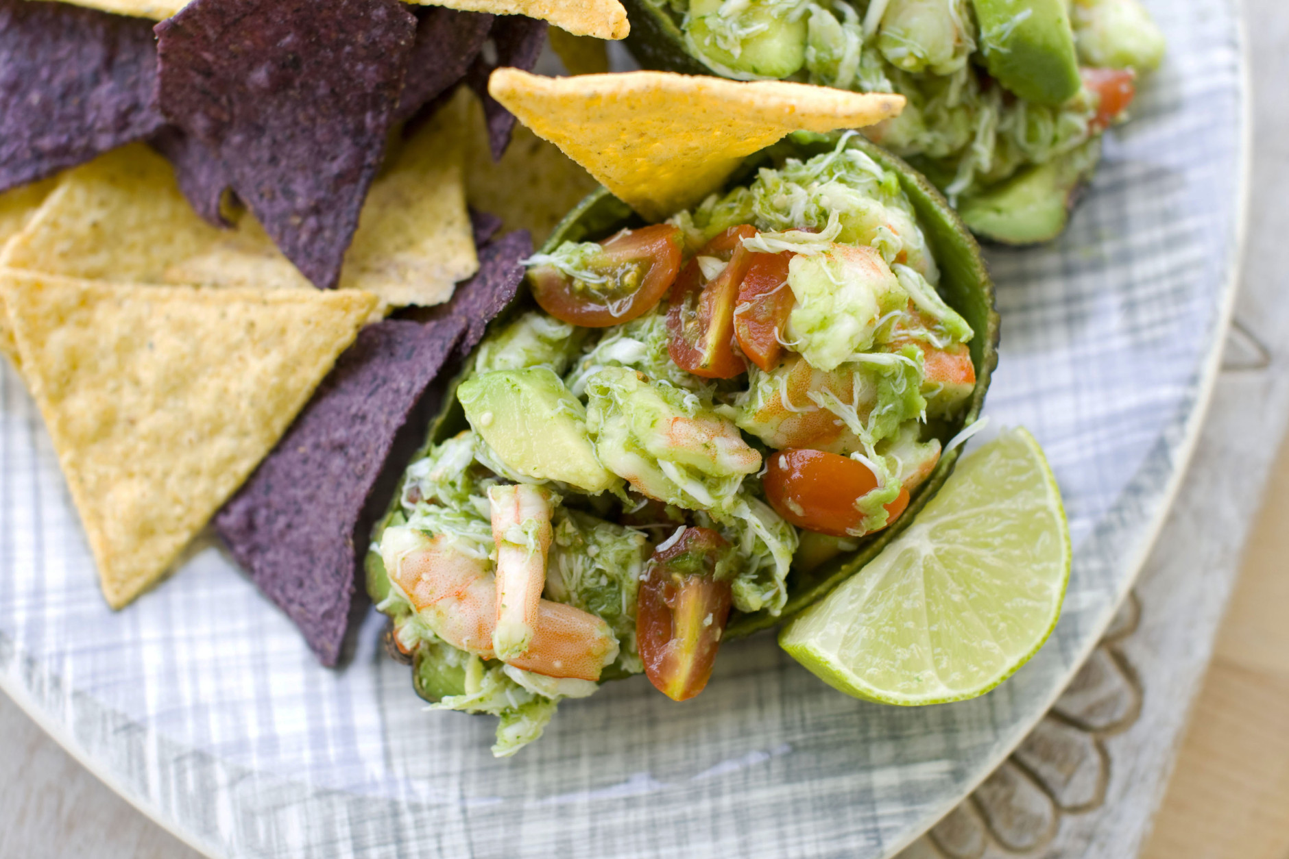 In this image taken on July 16, 2012, chef Elizabeth Karmel's recipe of cooked shrimp and crab in a light, chilled summer cerviche served with tortilla chips is shown in Concord, N.H. (AP Photo/Matthew Mead)