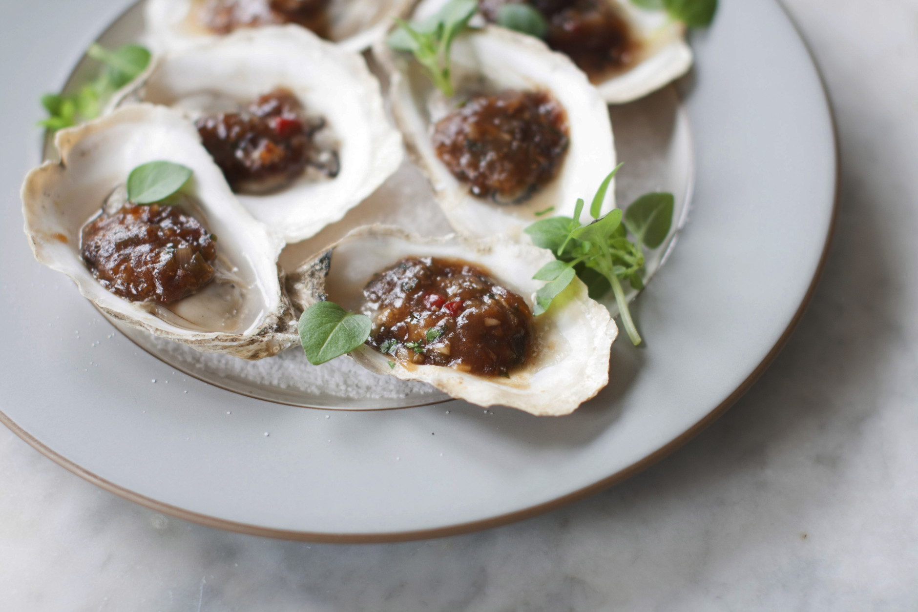 This Apr. 7, 2014 photo shows grilled oysters with fermented black beans and chili garlic in Concord, N.H. This recipe was inspired by chefs at the South Beach Wine and Food Festival in Miami Beach, Fla. (AP Photo/Matthew Mead)