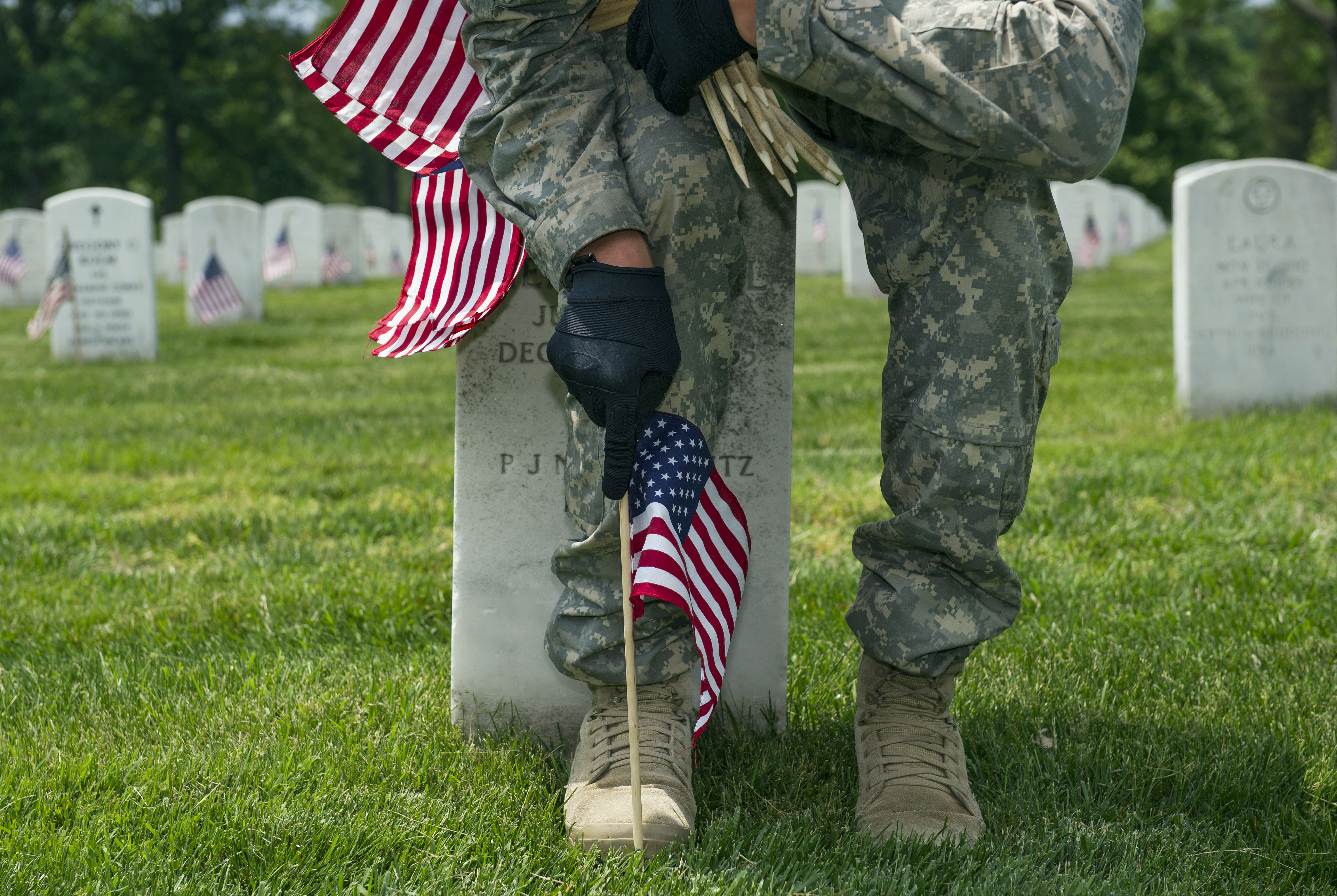 Flags being placed on Arlington National Cemetery graves