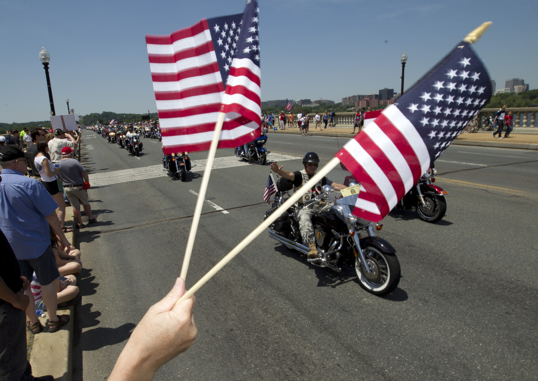 Participants in the Rolling Thunder annual motorcycle rally ride past Arlington Memorial Bridge  during the annual Rolling Thunder parade ahead of Memorial Day in Washington, Sunday, May 24, 2015.  (AP Photo/Jose Luis Magana)