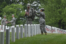 Members of the Old Guard place a flag in front of each headstone at Arlington National Cemetery in Arlington, Va., Thursday, May 21, 2015. Flags-In is a time honored tradition that is reserved for Soldiers of the 3rd U.S. Infantry Regiment (The Old Guard).  Since The Old Guard's designation as the Army's official ceremonial unit in 1948, they have conducted this mission annually at Arlington National Cemetery prior to Memorial Day to honor our nation's fallen military heroes. (AP Photo/Susan Walsh)