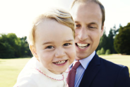In this handout image released by Kensington Palace on Tuesday July 21, 2015, Britain's Prince William holds his son Prince George following the christening of Princess Charlotte, in the grounds of Sandringham House, England, Sunday, July 5, 2015. The photo has been released in time for Prince George's second birthday on Wednesday, July 23, 2015. (Mario Testino/Art Partner/Kensington Palace via AP)   MANDATORY CREDIT EDITORIAL USE ONLY NO NO SALES NO COMMERCIAL USE ONE TIME USE ONLY
