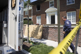 Police investigators continue working at a fire-damaged multimillion-dollar home in northwest Washington home, Friday May 22, 2015, where 46-year-old Savvas Savopoulos, his 47-year-old wife, Amy Savopoulos, the couple's 10-year-old son Philip, and housekeeper Veralicia Figueroa were found dead May 14. U.S. marshals and police arrested a dangerous ex-convict and took his five companions into custody, safely ending a multistate manhunt in the slayings of a wealthy Washington family and their housekeeper. The fugitive task force tracked Daron Dylon Wint to New York and back before they caught up with him late Thursday (AP Photo/Jacquelyn Martin)
