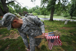 ARLINGTON, VA - MAY 21:  Members of the 3rd U.S. Infantry Regiment place American flags at the graves of U.S. soldiers buried at Arlington National Cemetery, in preparation for Memorial Day May 21, 2015 in Arlington, Virginia. 'Flags-In' has become an annual ceremony since the 3rd U.S. Infantry Regiment (The Old Guard) was designated to be an Army's official ceremonial unit in 1948.  (Photo by Win McNamee/Getty Images)