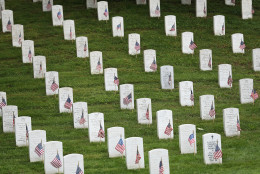 ARLINGTON, VA - MAY 21:  American flags placed by members of the 3rd U.S. Infantry Regiment at the graves of U.S. soldiers buried at Arlington National Cemetery in preparation for Memorial Day are seen May 21, 2015 in Arlington, Virginia. 'Flags-In' has become an annual ceremony since the 3rd U.S. Infantry Regiment (The Old Guard) was designated to be an Army's official ceremonial unit in 1948.  (Photo by Win McNamee/Getty Images)