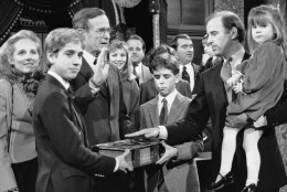 FILE - In this Jan. 3, 1985 file photo, Sen. Joe Biden (D-Del.) holds his daughter, Ashley, while taking a re-enacted oath of office from Vice President George Bush during a ceremony on Capitol Hill in Washington as his sons Beau, foreground, and Hunter hold the bible. On Saturday, May 30, 2015, Vice President Joe Biden announced the death of son, Beau, from brain cancer. (AP Photo/Lana Harris)