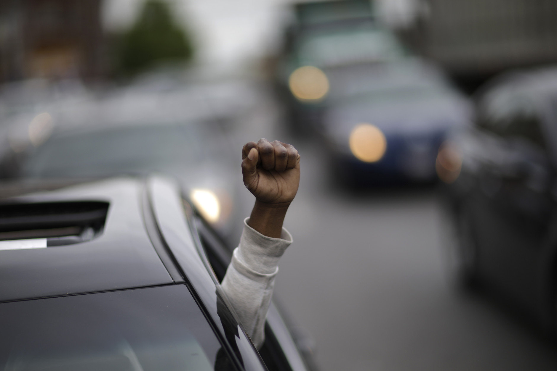Meach Johnson celebrates on Friday, May 1, 2015, after State's Attorney Marilyn J. Mosby announced criminal charges against all six officers suspended after Freddie Gray suffered a fatal spinal injury while in police custody in Baltimore.  Mosby announced the stiffest charge, second-degree depraved heart murder, against the driver of the police van. Other officers faced charges of involuntary manslaughter, assault and illegal arrest. (AP Photo/David Goldman)